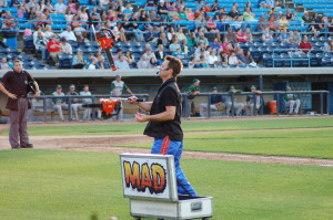 "Chainsaw juggler ""Mad Chad performs at a Whitecaps game in 2012"