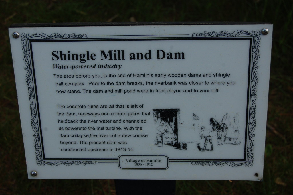 Interpretive signs along the paved pathway detail the area's rich lumber history