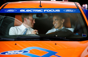 President Obama sits in an electric Ford Focus alongside Holland, Michigan, Mayor Kurt Dykstra. (PHOTO CREDIT: Getty Images)