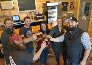 Upper Hand Staff Celebrates Opening of Taproom