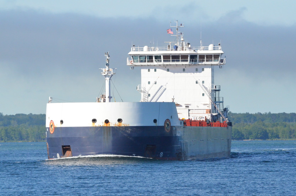 Freighter Algoma Harvester passes by our Soo Locks Boat Cruise boat