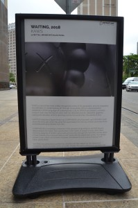 Waiting by KAWS informational sign Michigan Detroit