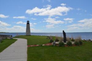 Gladstone Michigan Lighthouse and Fisherman Statue