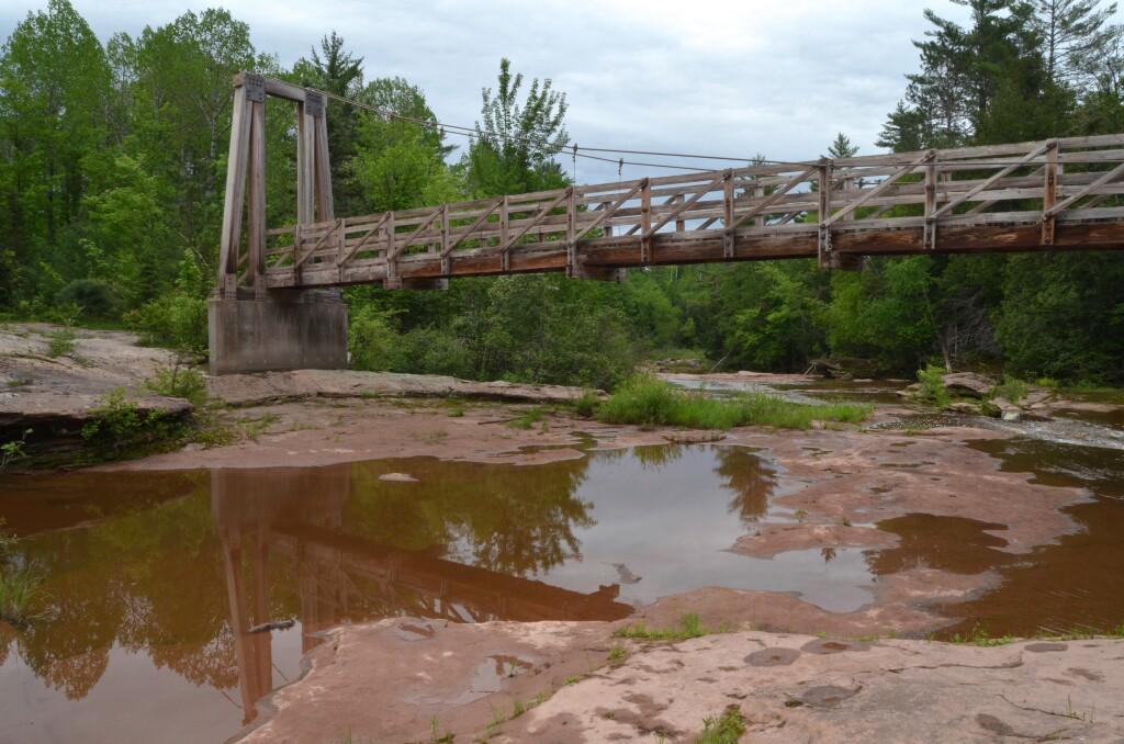 Suspension Bridge on the North Country Trail by O-kun-de-kun Falls, June