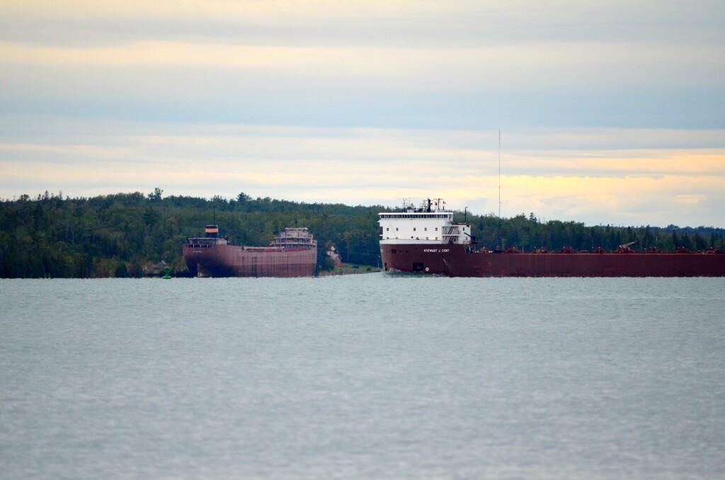 Freighter Stewart J. Cort passes the long laid-up freighter John Sherwin, Drummond Island, September